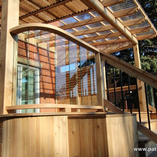 Deck curved railing with tempered glass inside