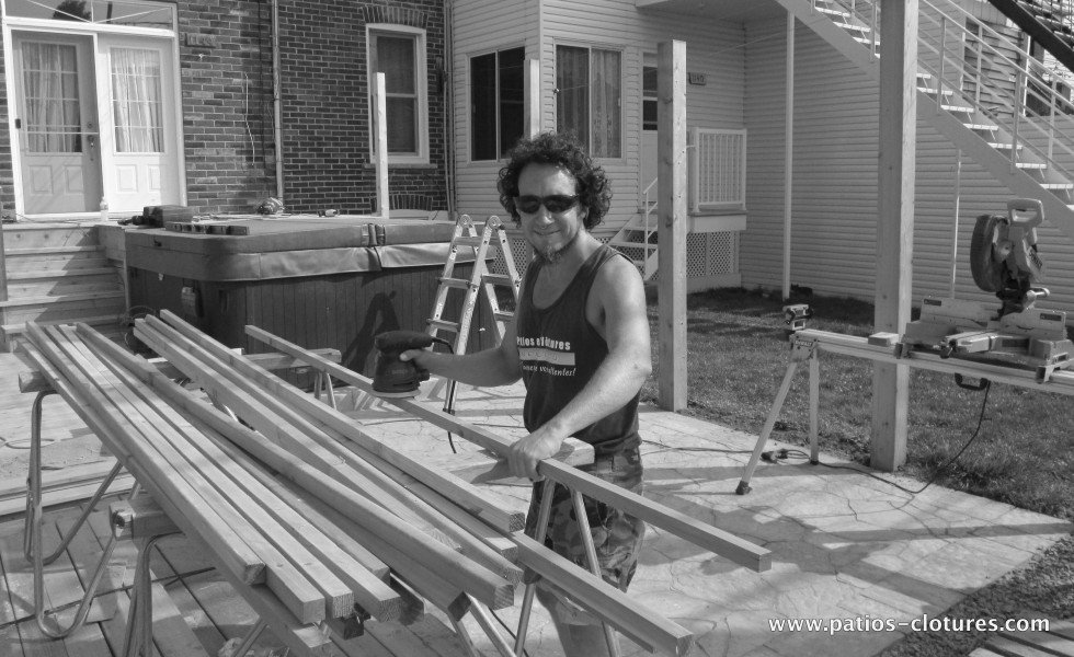 happy carpenter during the construction of a deck