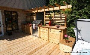 Cuisine extérieure sur patio avec spa Legault