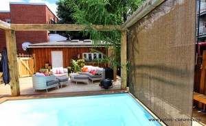 Privacy screen attached to the pergola