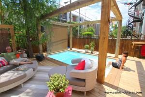 Patio with ipe wood border around an inground pool