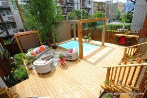Video of the construction of a wooden deck around an inground pool in Montreal