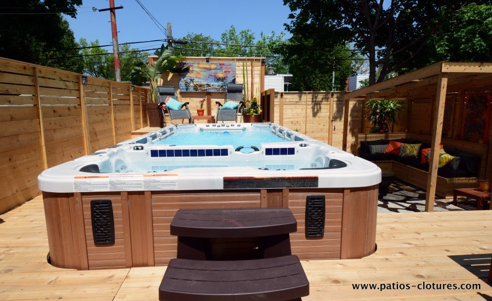 Swim spa hot tub surrounded by a deck