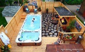 Vidéo du patio avec spa de nage et de la nouvelle cour de la famille Vandal à Montréal.