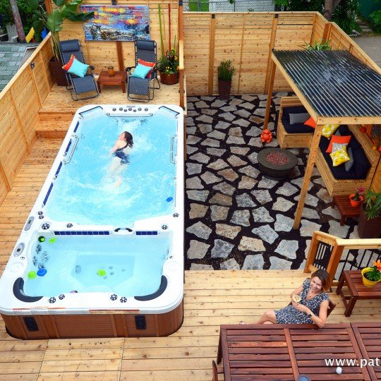 Patio with swim spa, view of the entire backyard