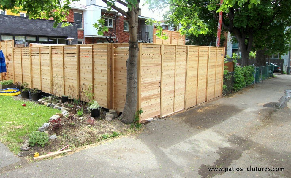 Cedar fence with boards laid horizontally, Vandal job