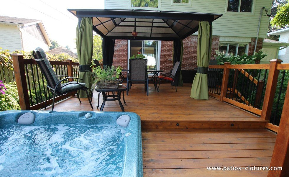 Covered dining area of a deck with hot tub