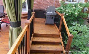BBQ area on top of stairs of a deck