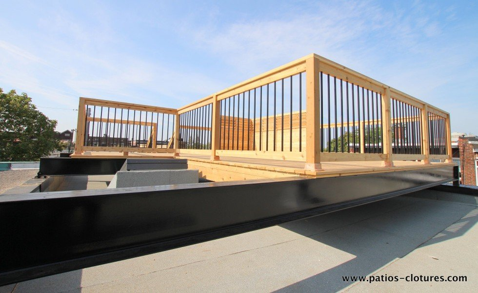 Rooftop deck terrace supported by steel beams