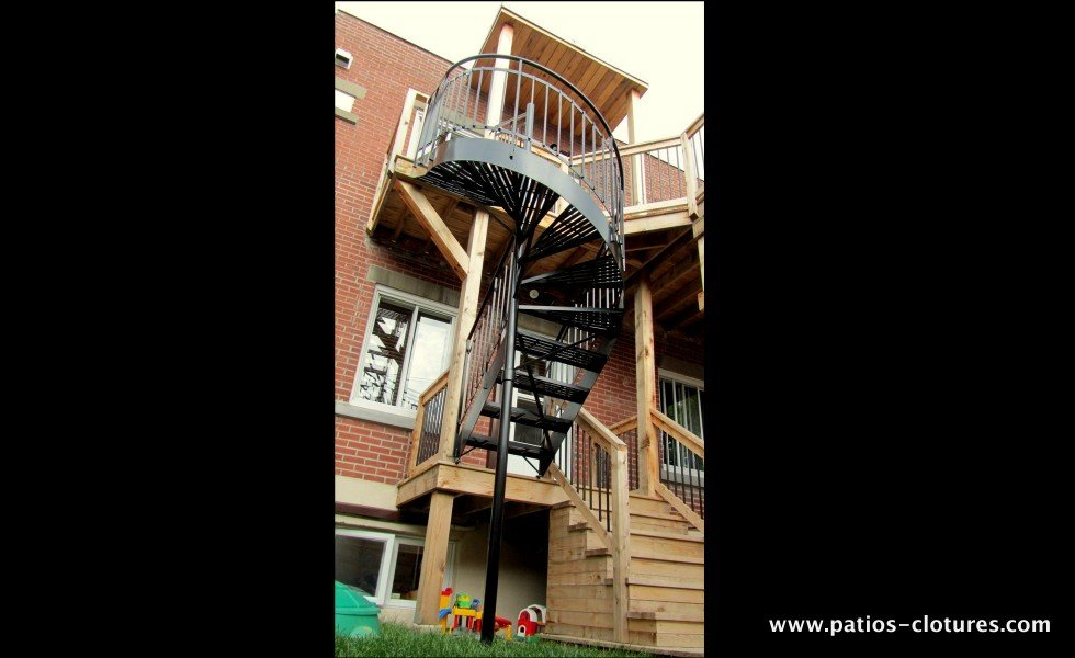 Spiral staircase made of aluminum from the first floor to the second floor of a two-story patio