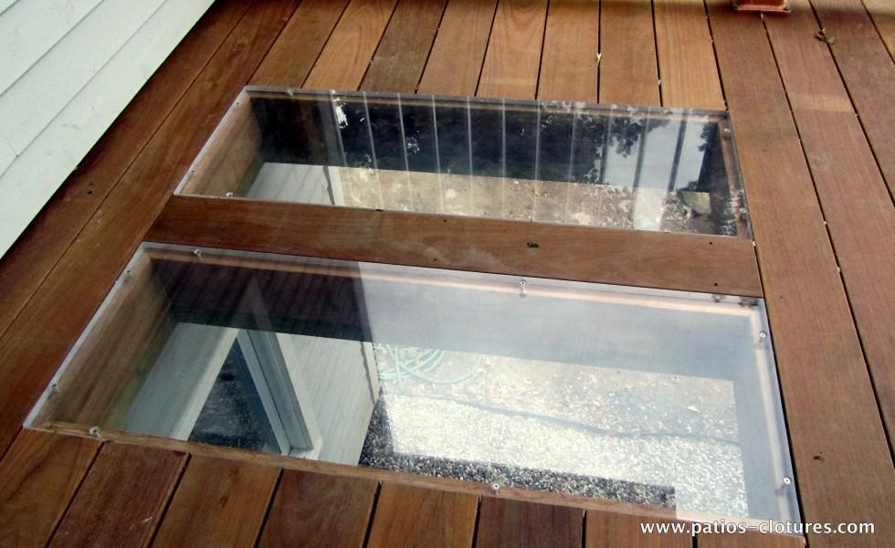 Plexiglass dans le plancher pour permettre à la lumière de se rendre au fenêtres du sous-sol