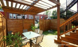 Patio with dining area and pergola above