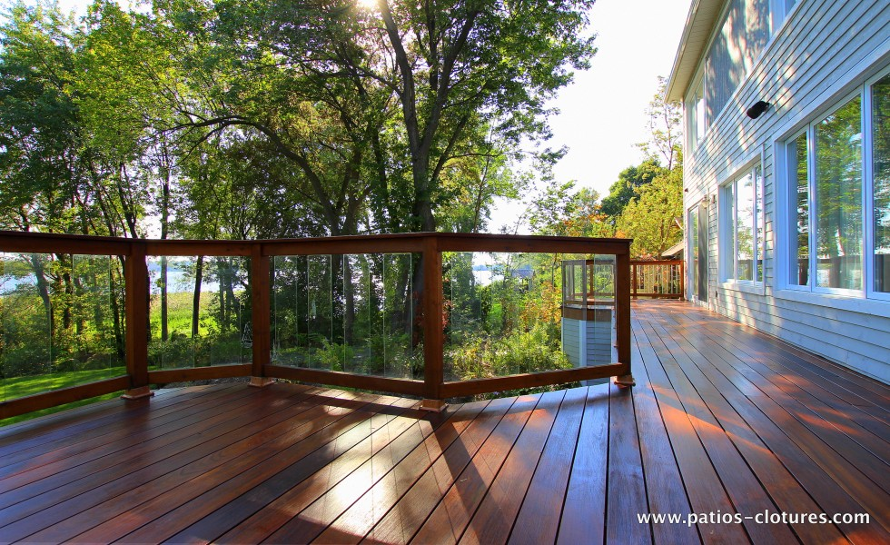 Balcony with Ipe floor and red cedar railing with tempered glass panels