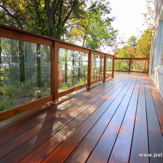 Ipe balcony floor and red cedar railing with tempered glass panels