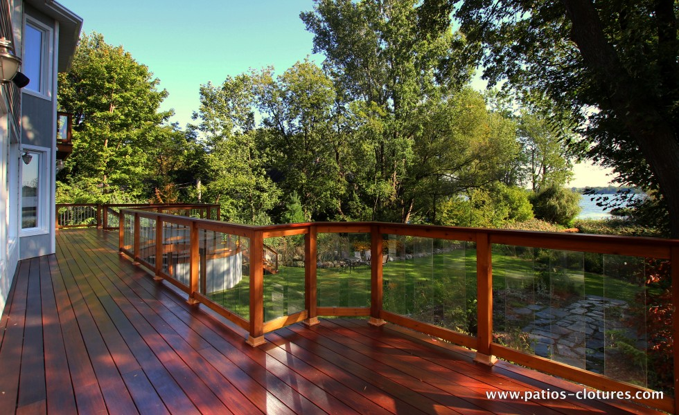 View of the river on the balcony with Ipe floor. Red cedar railing with tempered glass panels