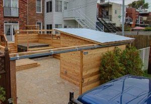 Porte coulissante simple avec cabanon intégré à la clôture (projet Brouillette)