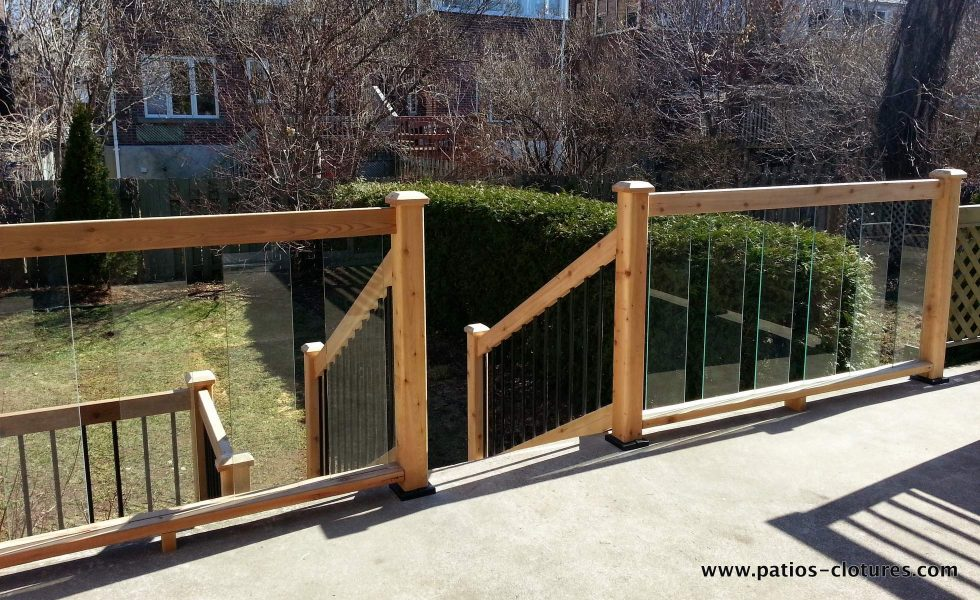 -backyard view- Concrete deck with cedar and tempered glass railing