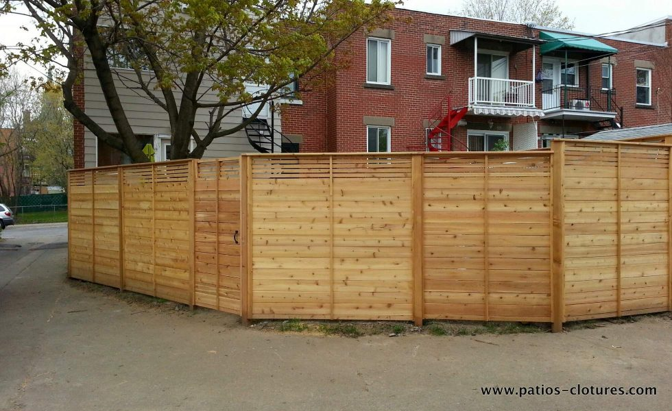 Larger view - back alley side of the horizontal palissade fence Peek-a-boo with smaller top slats