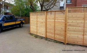 Back alley side of the horizontal palissade fence Peek-a-boo with smaller top slats