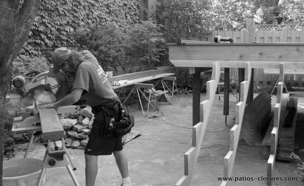 Alex during the construction of the patio deck Labadie.