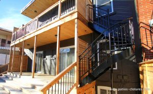 Side view. Replacement of the balconies by two new balconies and an aluminum spiral staircase. Gendron patio.