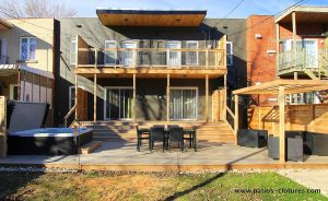 Front view. Replacement of the balconies by two new balconies, an aluminum spiral staircase, a low terrace including a spa, a dining area and a lounge area with pergola. Gendron patio.