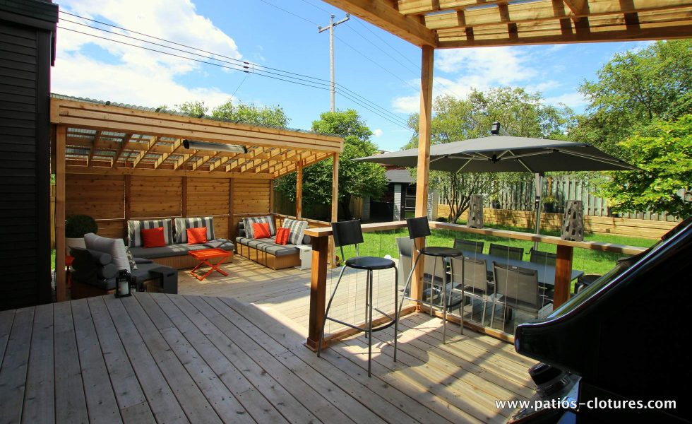 Inside view of the patio covered BBQ area Sylvie showing the dining area and the lounge area.