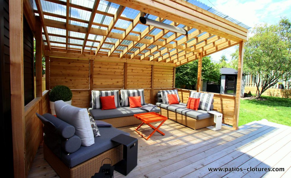 Lounge area with transparent roof and privacy screen with shutters. An electric radiant heating system allows you to enjoy this outdoor space during cool evenings. For more information on outdoor radiant heating systems visit https://www.patios-clotures.com/heating-for-wood-patios