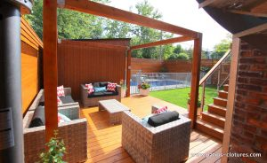 Rear view of the intimate lounge, shed and in-ground pool. (Rigal project)