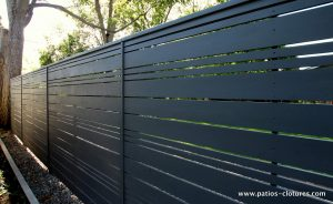 View from outside the yard of a horizontal fence with alternate openwork style (stained dark gray)