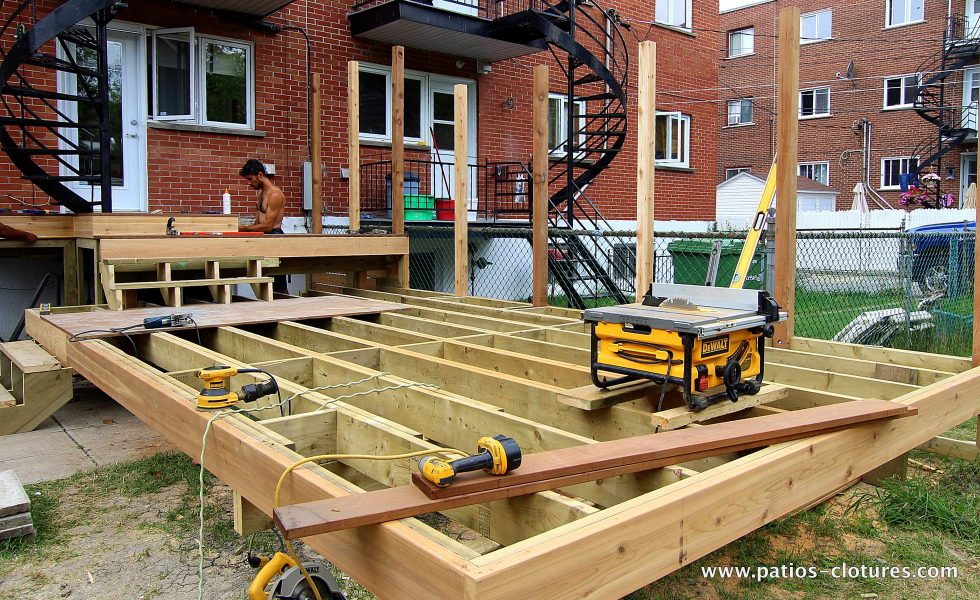Blanchette patio construction. A two-level cedar patio with Ipe wood flooring.