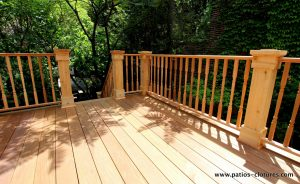 View of the stairs. Patio with an Ipe wood floor and colonial style cedar railings. Patio deck Labadie.