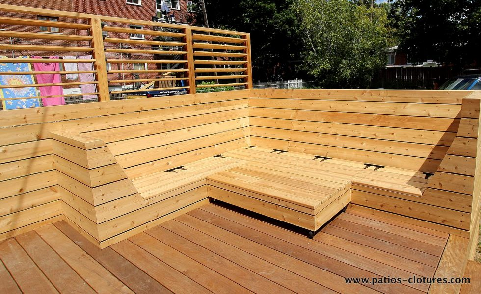 Custom cedar corner couch without cushions. View of the storage under the seats. Blanchette patio.