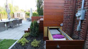 Tiroir étanche Pylex en dessous du patio, pour optimiser l'espace et le rangement
