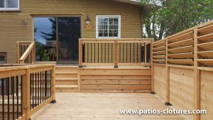 Bistro corner on the top level of a two-level cedar deck