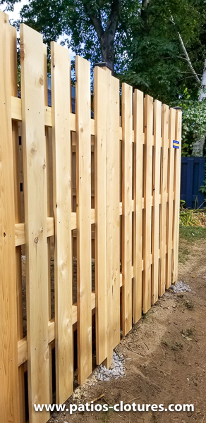 Good neighbor cedar fence 6 'high with 3 horizontal 2x4s (partial view through at an angle)