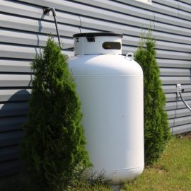 homeguide-large-250-gallon-propane-tank-installed-aside-residential-home